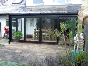black lean-to conservatory with patio doors