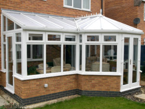 p-shaped conservatory with a dwarf wall