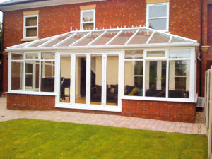 white conservatory with bifold doors